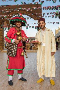 DUBAI, UAE - DECEMBER 4, 2017: men in national costumes in entertainment center Global Village stock vector
