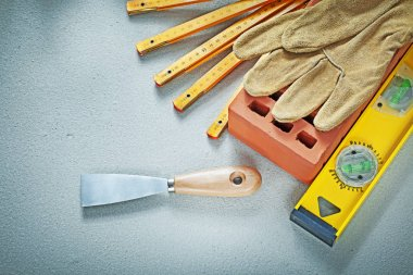 Red brick protective gloves palette knife construction level on