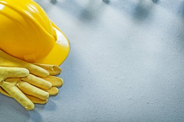Hard hat safety gloves on concrete surface construction concept