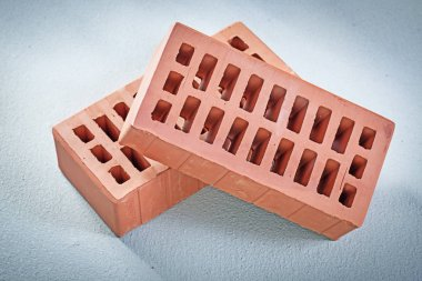 Red bricks on concrete background bricklaying concept