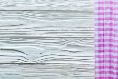 Pink white checked fabric on wooden board
