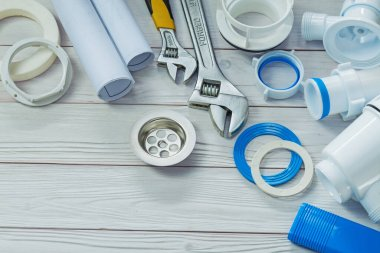 piping accessories white sanitary plastic pipes on painted wood