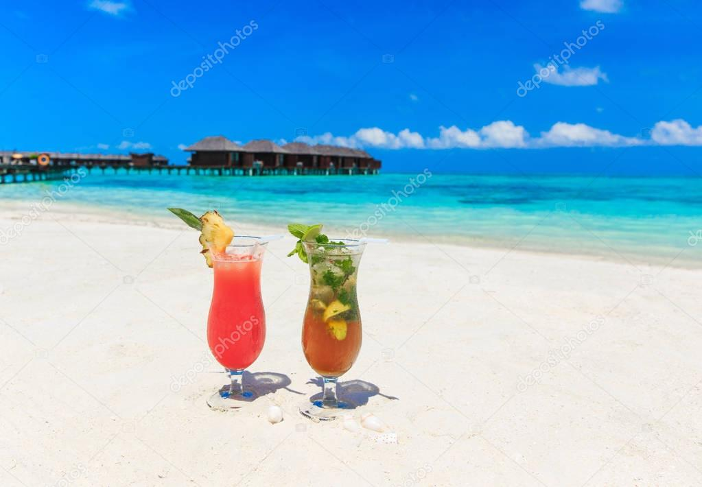Two bright cocktails on the beach