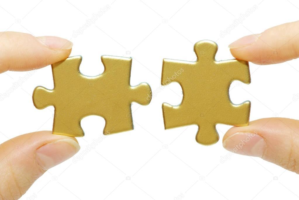 puzzle pieces in hands