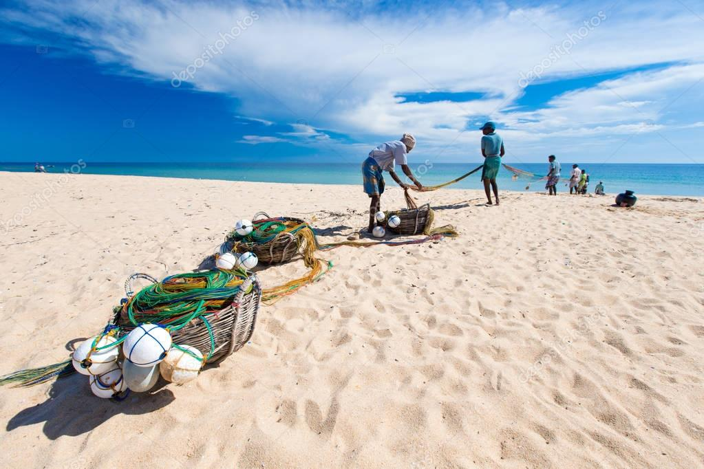 Local fishermen pull a fishing net from Indian Ocean