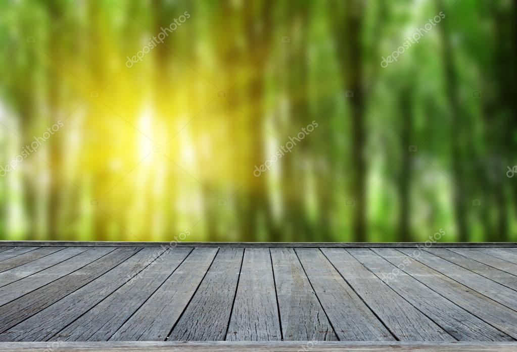 Фотообои  wooden deck table with forest background