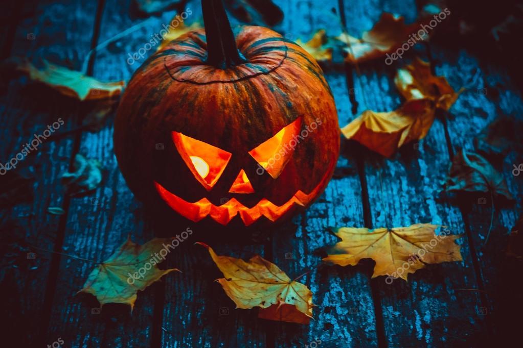 Glowing pumpkin in darkness
