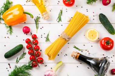 Spaghetti and ingredients for salad