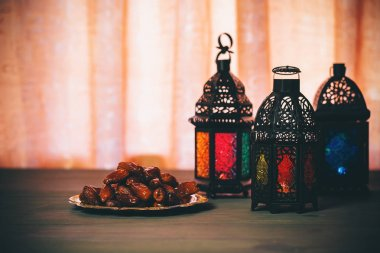 The Muslim feast of the holy month of Ramadan Kareem. Beautiful background with a shining lantern Fanus with dried dates. Free space for your text. stock vector