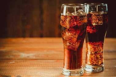 cola soda with ice cubes in glasses