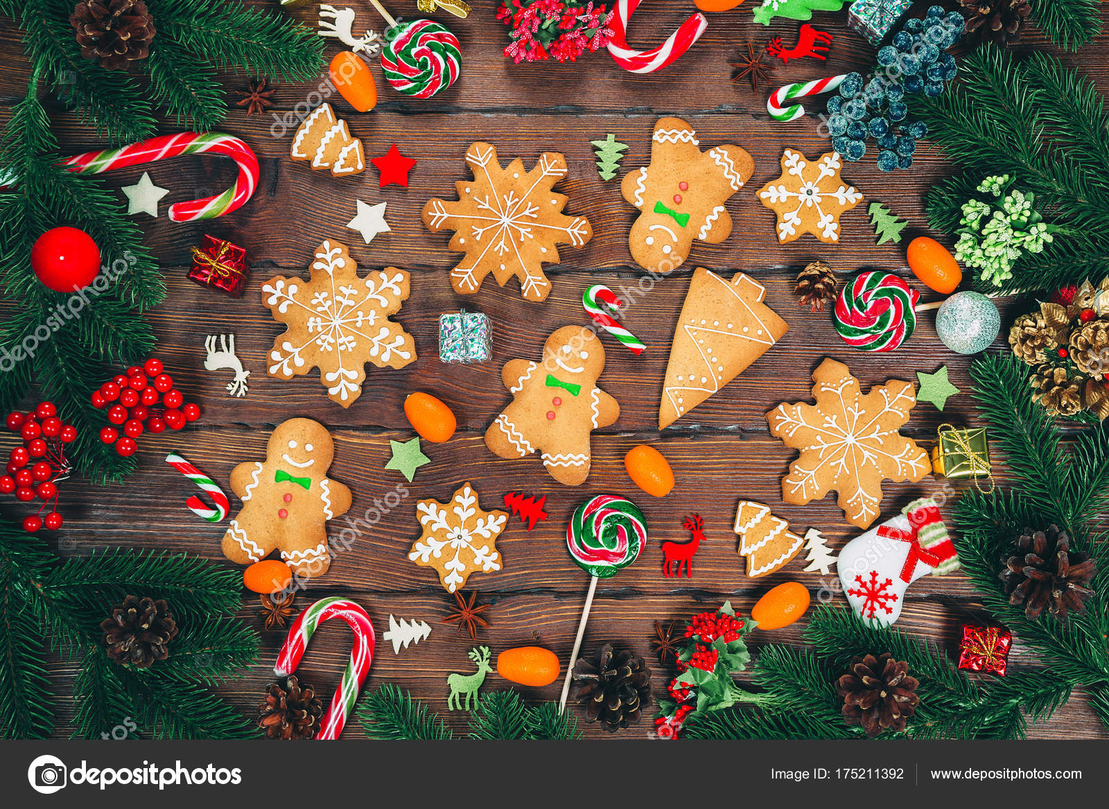 Christmas gingerbread cookies homemade on wooden table with candies and New Year decorations. Xmas background– stock image