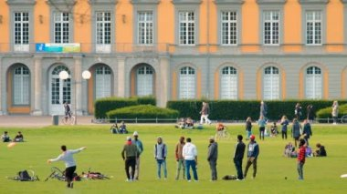Bonn, Germany, 02 of November 2017: Multiethnic Students In Park In Front Of Bonn University In Good Autumnal Weather