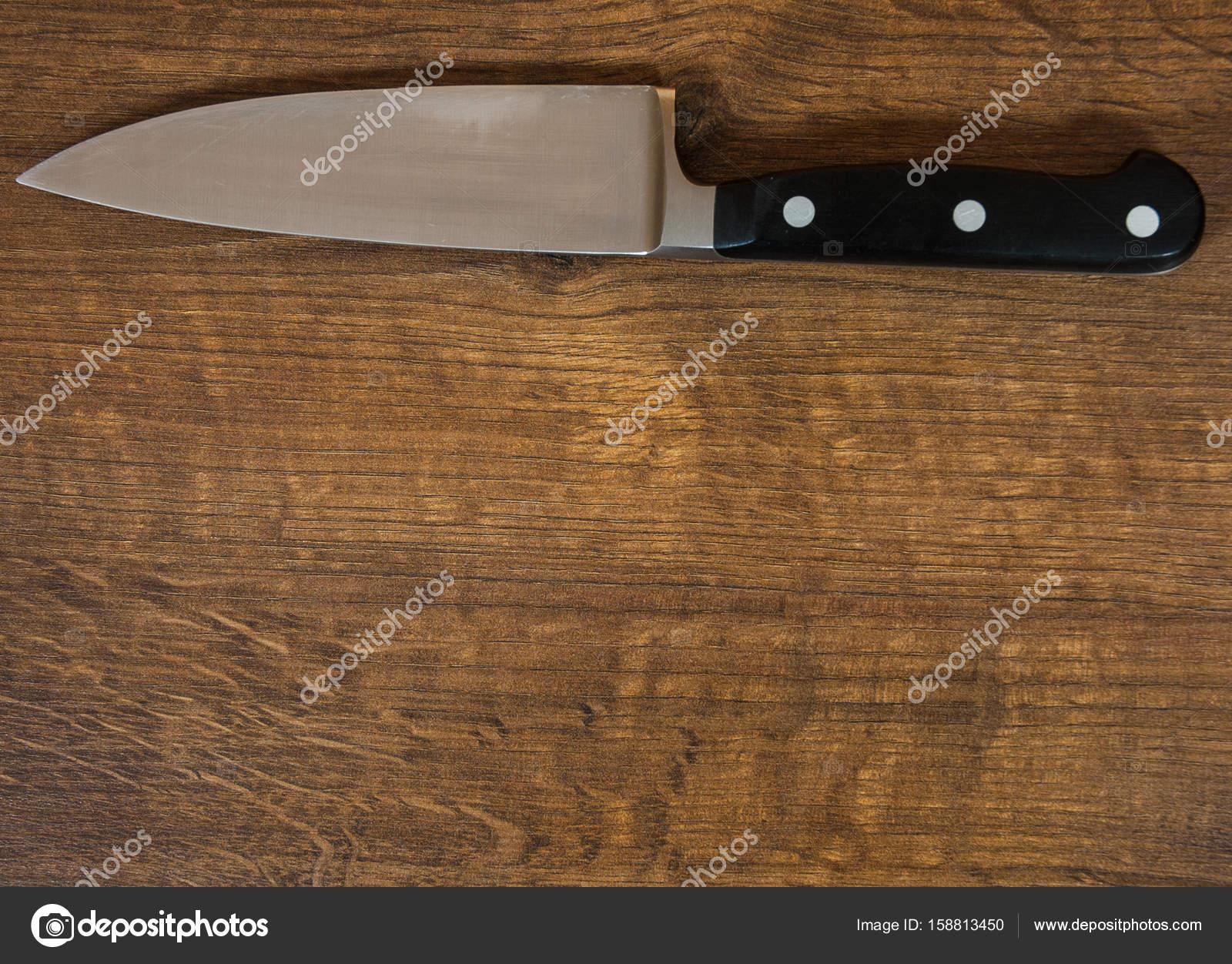 Küchenmesser Küchenchef auf dem braunen Holztisch Hintergrund ...