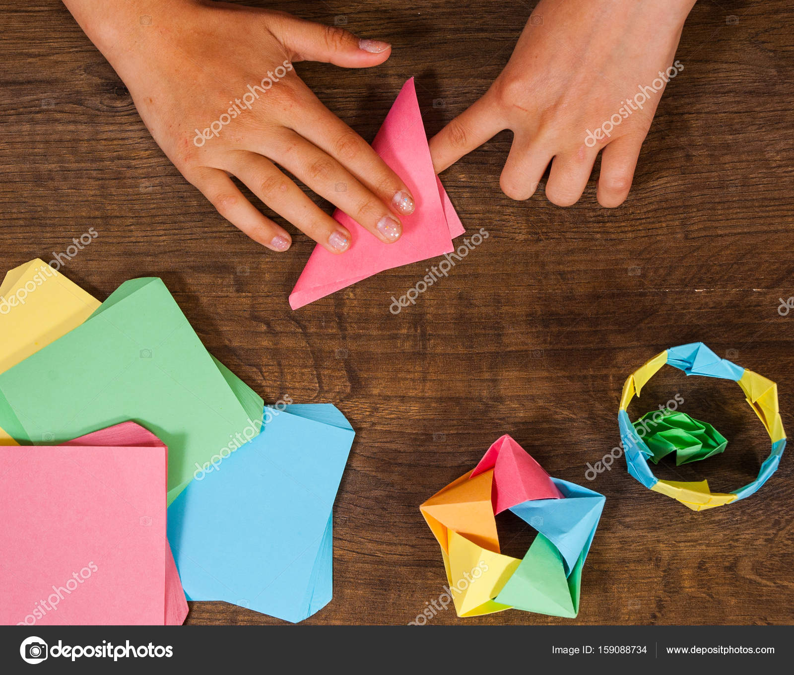 Childrens Creativity Made Of Paper Origami Crafts Handicrafts For Children Handmade On Wooden Table Top View Photo By Semenovp