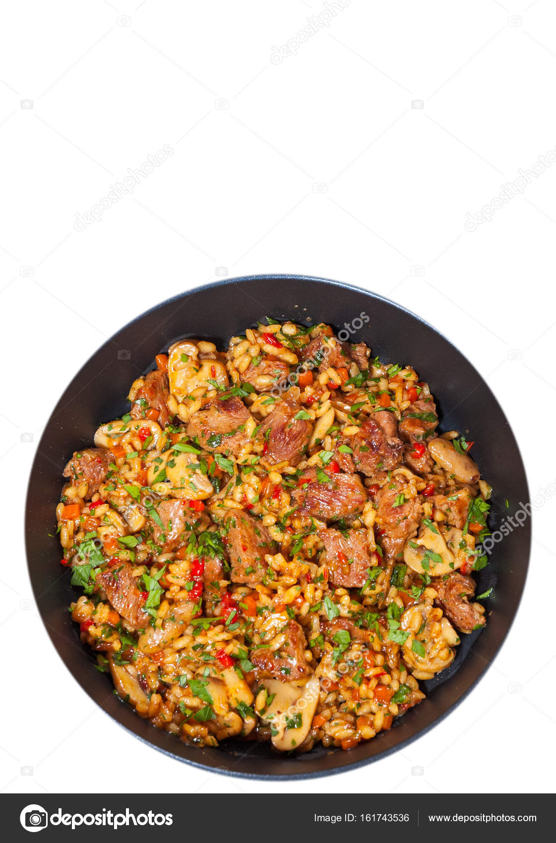 Rice With Meat Vegetables And Mushrooms In A Frying Pan