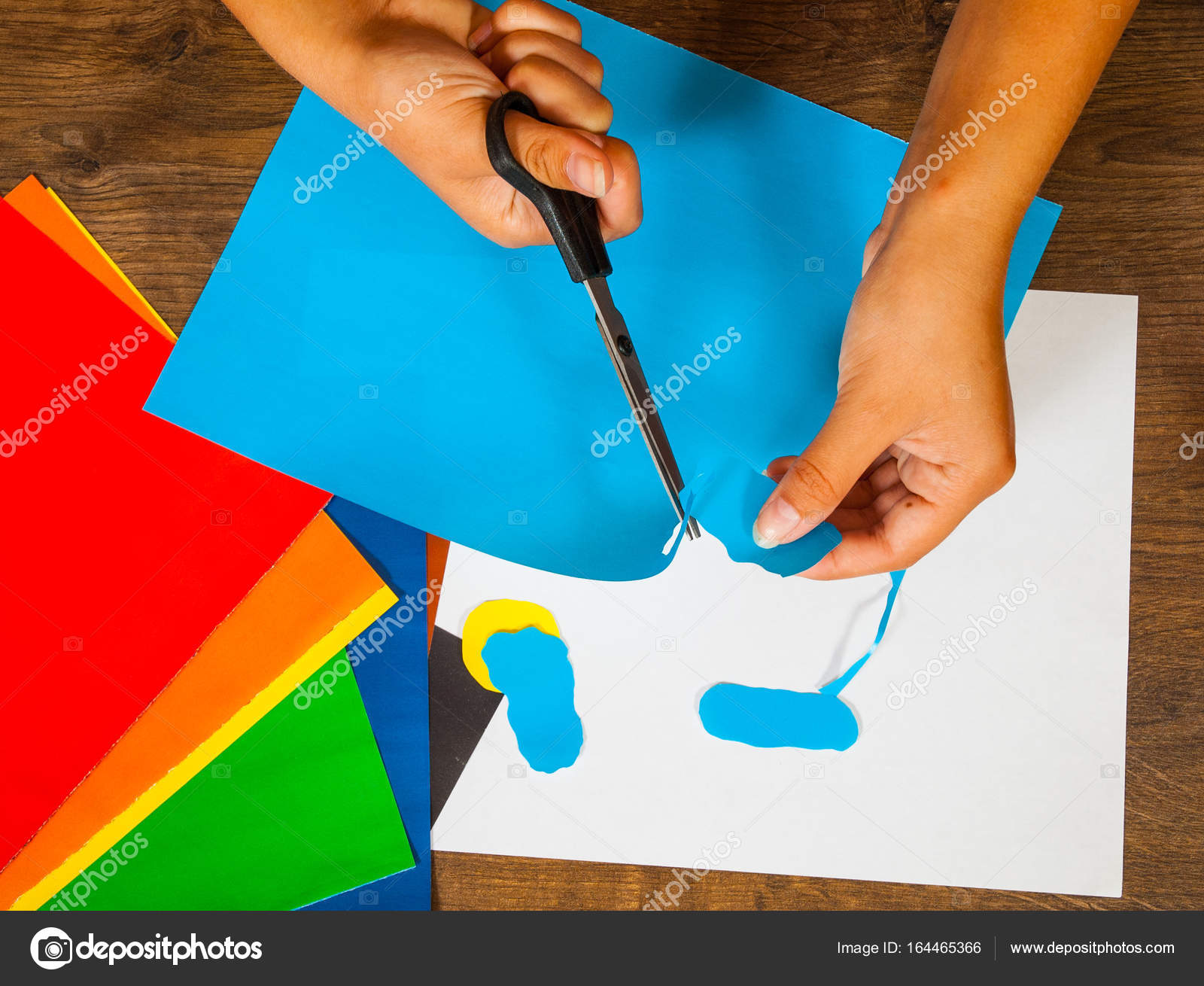 Child Cuts Out Of Paper Sheets Colored Kids Art Crafts Concept Handmade On Wooden Table Top View Photo By Semenovp