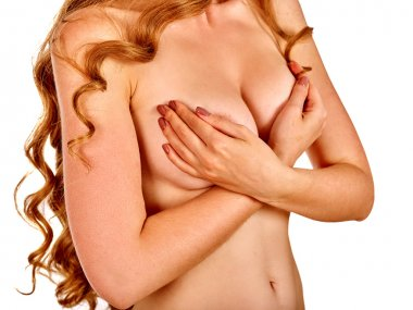 Health self exam. Girl coverds her nude breast of hands.