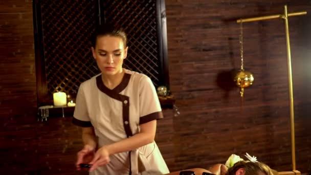 Lastone therapy massage in spa salon. 4k