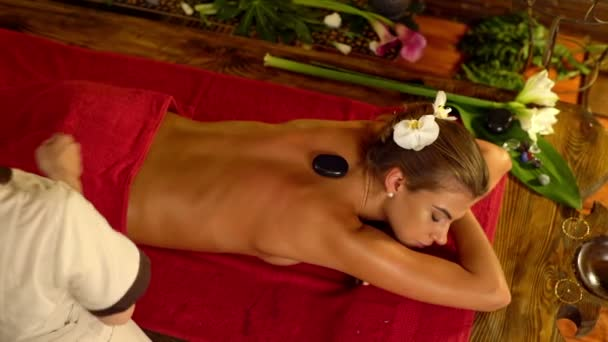 Lastone therapy massage in spa salon. 4k