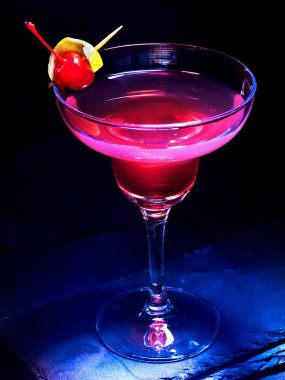 Cherry alcohol cocktail on black background .