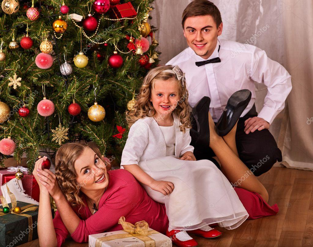 Christmas family portrait with children dressing Xmas tree ...