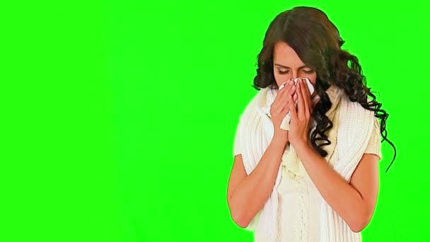 Cold girl blowing his nose on green screen.
