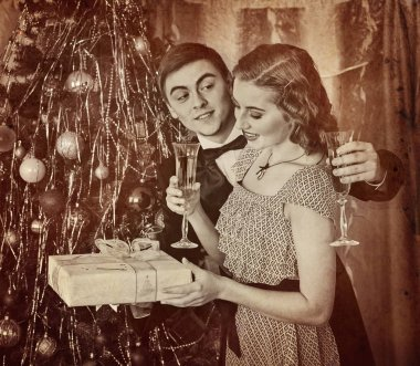 Retro vintage portrait of couple Christmas party. Black and white .