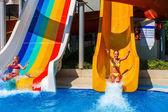 Swimming pool slides for children on water slide at aquapark.