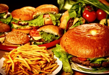Fast food hamburger and french fries for large group friends.
