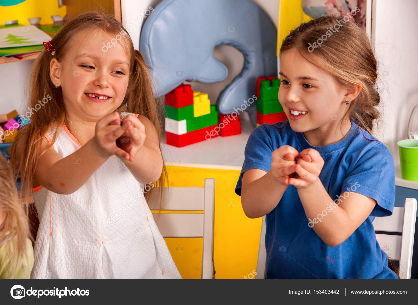 Finger Game On Break School In Painting Class Small Student In Art Class Physical Education Of Little Girls Playing Craft Drawing Develops Creative