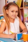 Fotografie Small students children painting in art school class.