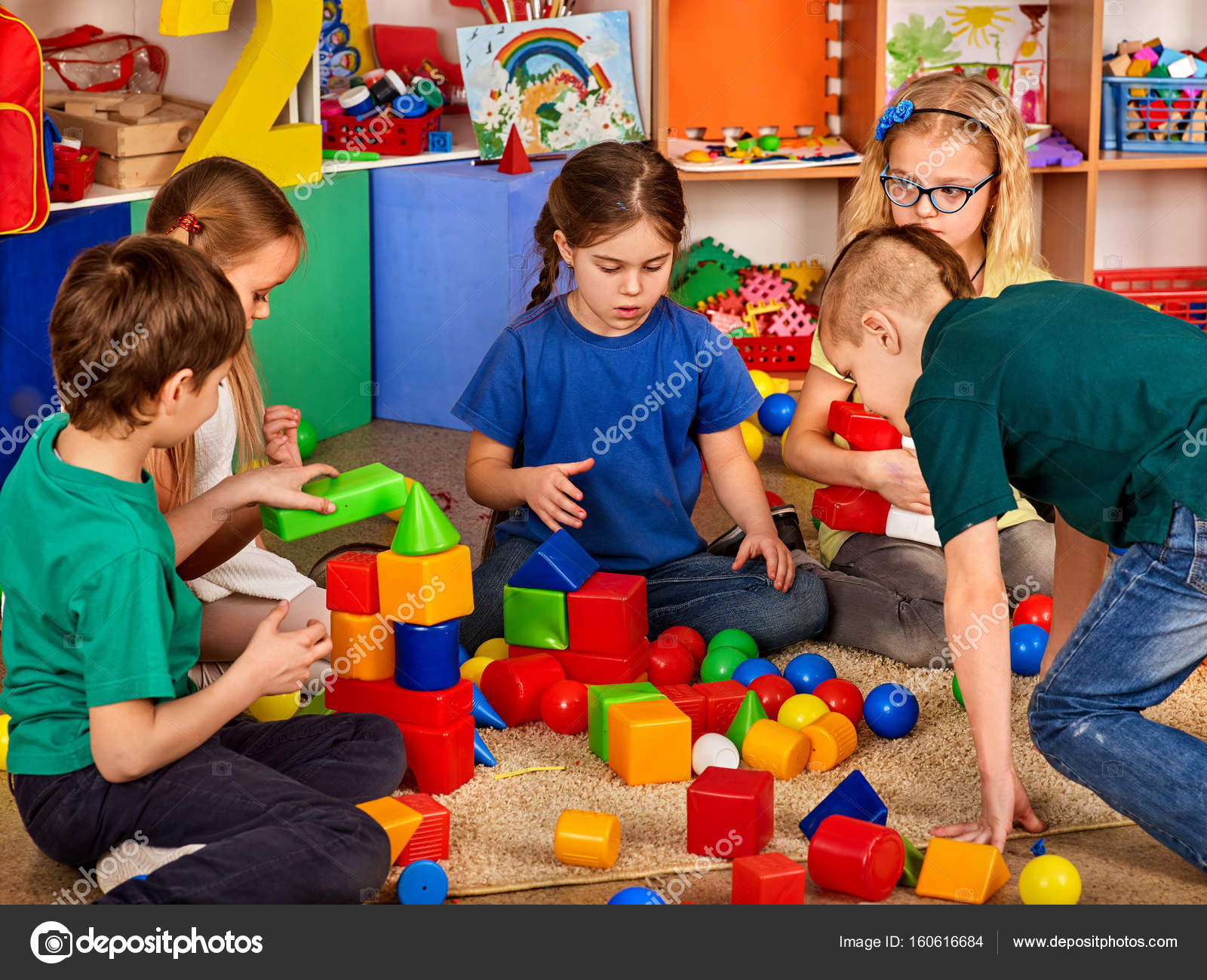 Children building blocks in kindergarten Group kids playing toy