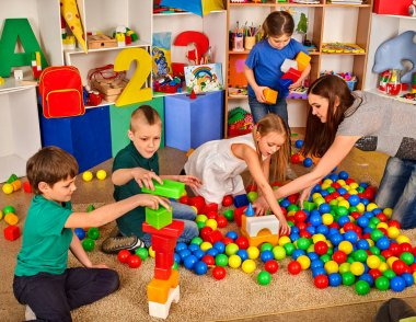 Children playing in kids cubes indoor. Lesson in primary school.