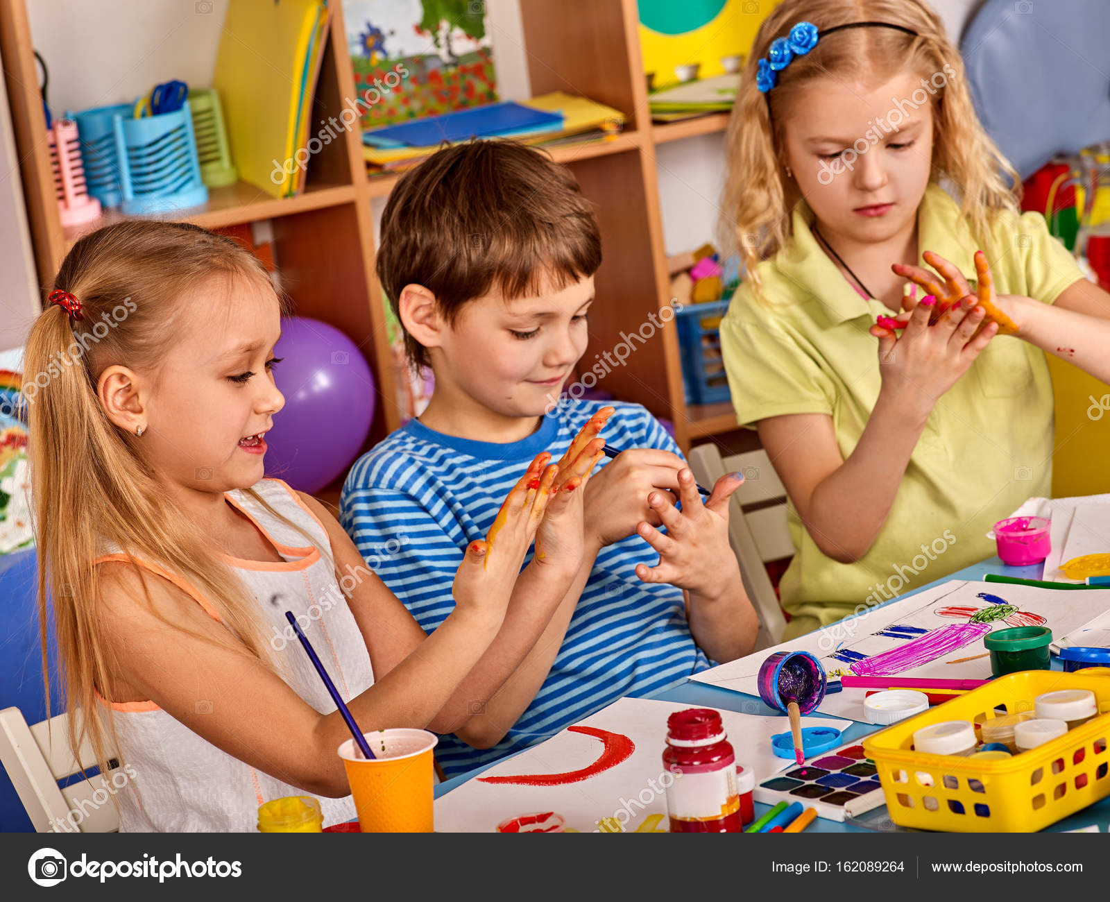 Small Students Girl Finger Painting In Art School Class Stock Photo