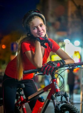 Girls children cycling on yellow bike lane.