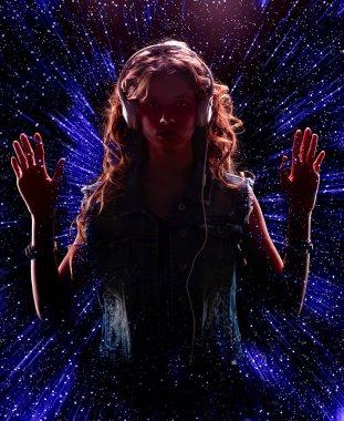 Girl wearing music headphone on stars night background.