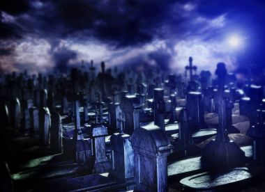 Halloween night in cemetery grave.