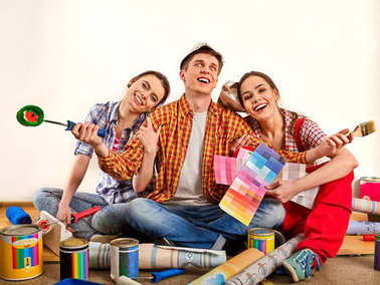 Repair group of people building home using paint roller tools.