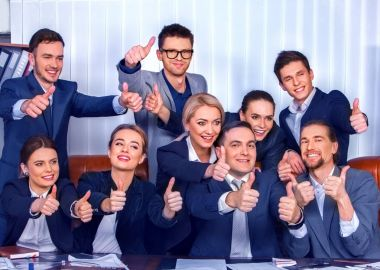 Business people office life of team people are happy with thumb up.