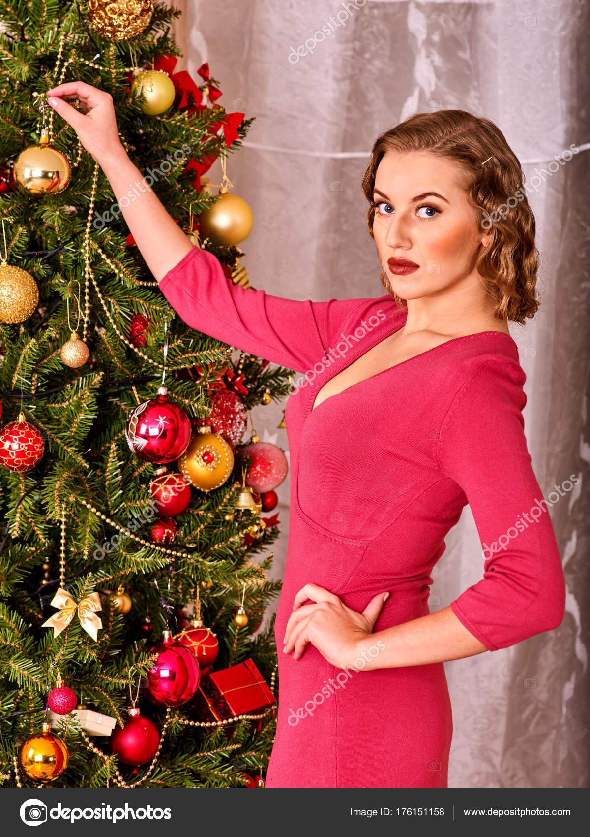 Woman dressing Christmas tree. — Stock Photo © poznyakov #176151158