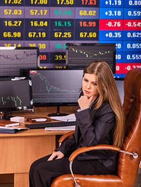 Stock exchange people. Trader woman sitting table surrounded by monitors.