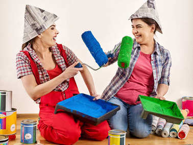 Repair home women holding bank with paint for wallpaper.