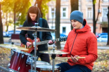 Music street performers on autumn outdoor. Middle section of body part.
