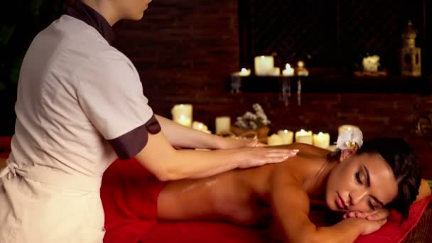 Massage in spa salon with woman and masseur.