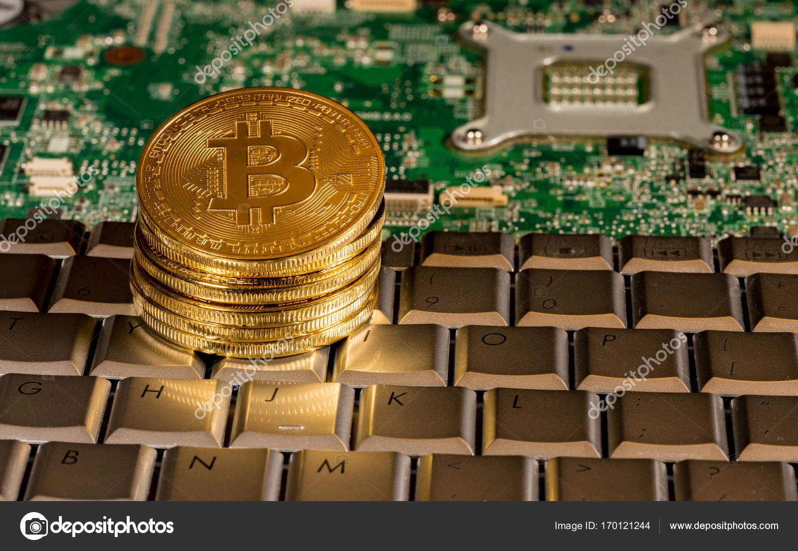Bitcoin On A Keyboard With Printed Circuit Board Stock Editorial Electronic Royalty Free Photography Photo Coin Computer To Illustrate Blockchain And Cyber Currency By Steveheap