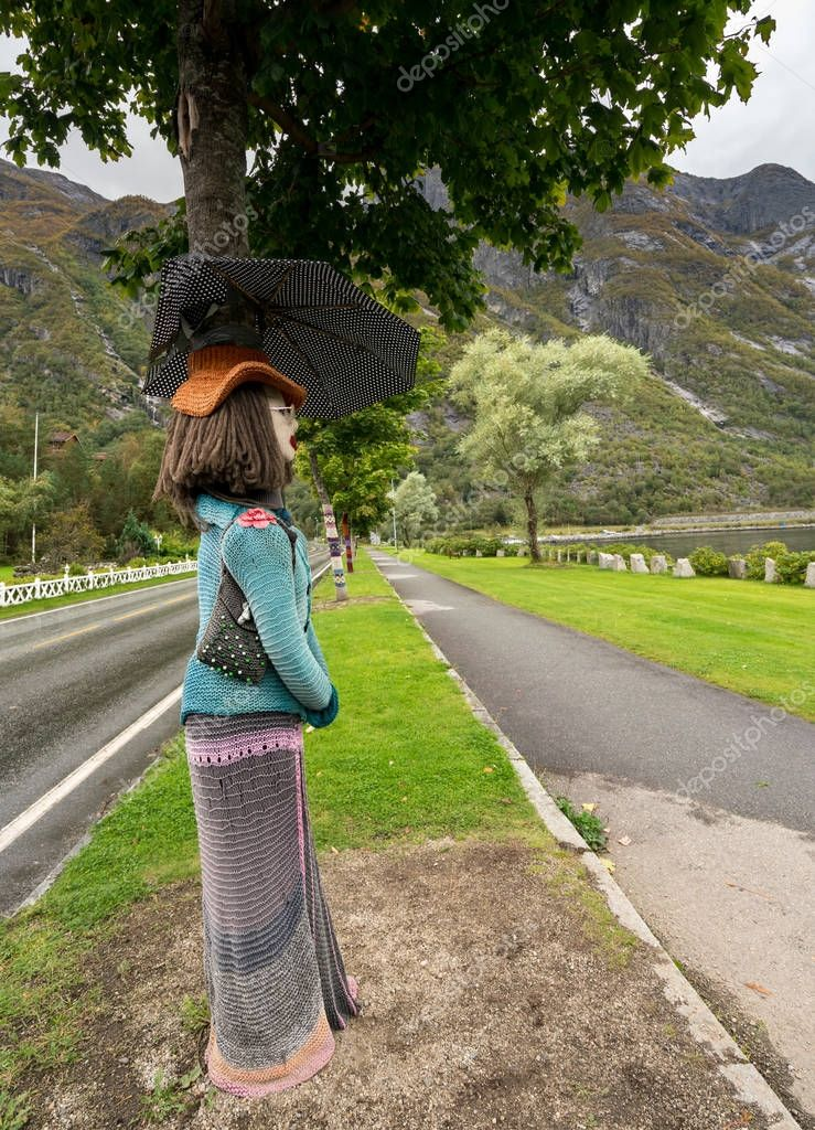 Woolen knitwear covers tree trunks at Eidfjord in Norway