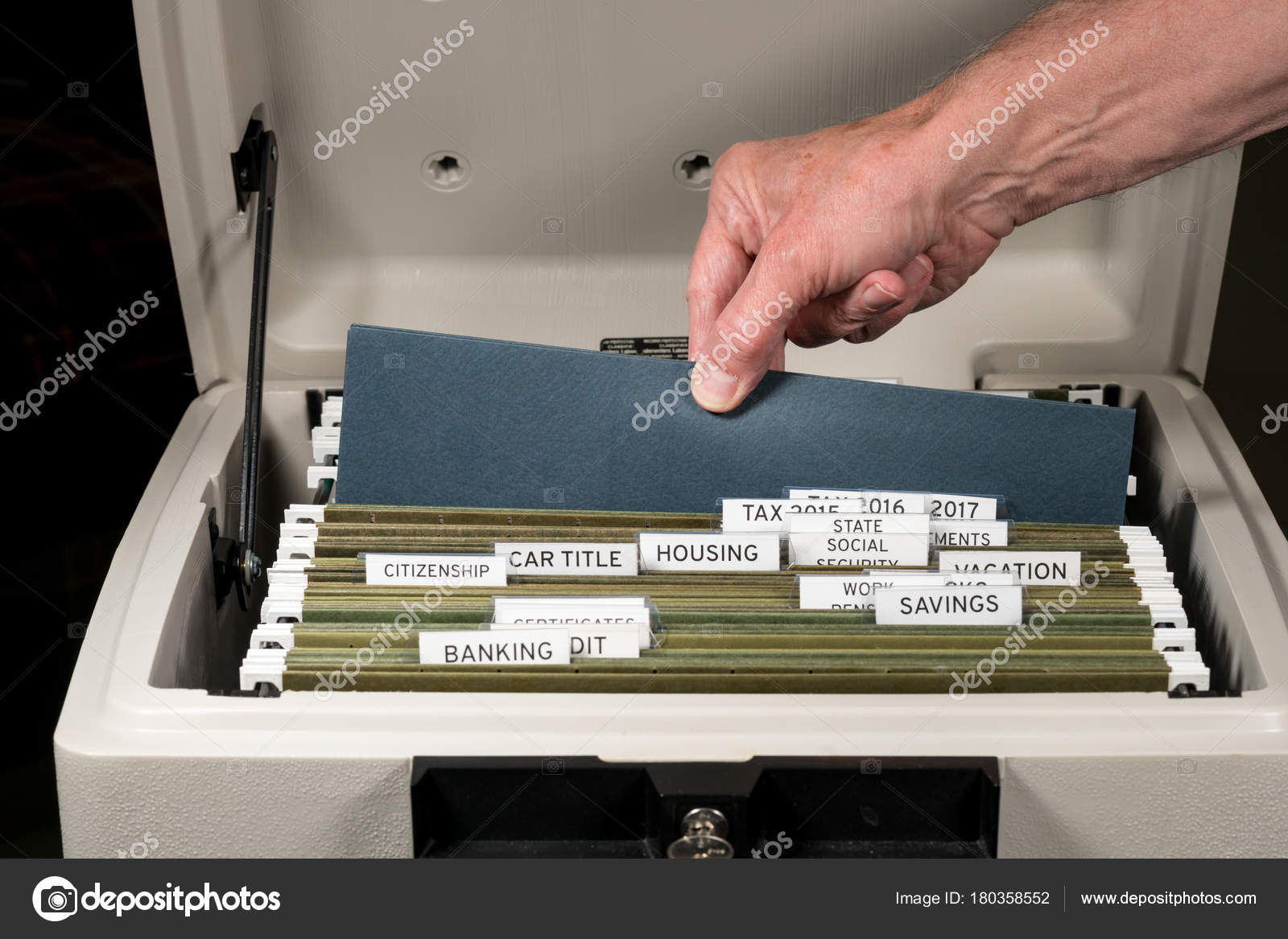 Home filing system for taxes organized in folders Stock Photo