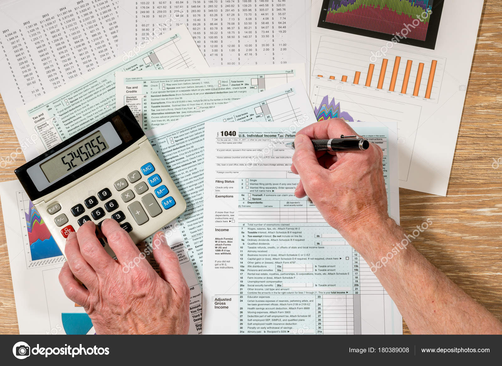 From above view of 2017 irs form 1040 on wooden desk stock photo from above view of 2017 irs form 1040 on wooden desk stock photo falaconquin