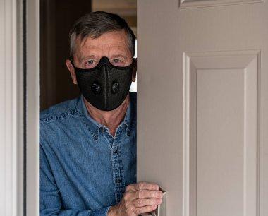 Worried senior caucasian man wearing protective mask against corona virus