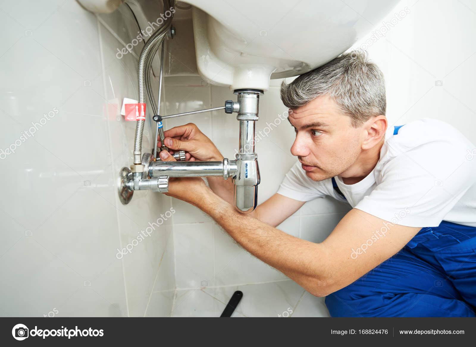 plumber man repair leaky faucet tap — Stock Photo © kalinovsky ...
